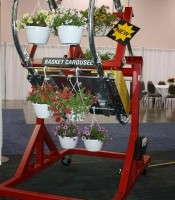 Mechanized Basket Elevator Makes Loading Conveyors Easier