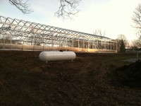 Hoop houses alone failed to meet Judges Farms herb-growing needs.