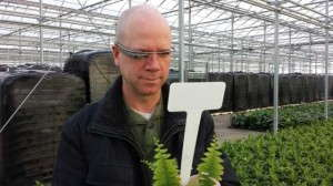 Michael Camplin, GGS Sales Manager, scanning a potted plant's tag with Google Glass at Hendriks Greenhouses