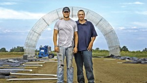 Cody B. Morse (left) and John P. Gaus stand on the site for the new 15,000-foot facility for Agbotic